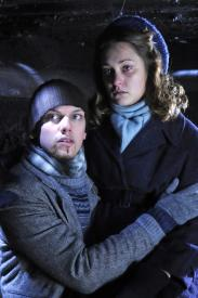 Jamie Campbell Bower and Melody Klaver in Winter in Wartime.