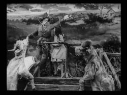 The Scarecrow and Dorothy in The Wonderful Wizard of Oz.