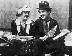 Edna Purviance and Charlie Chaplin.