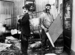 Charlie Chaplin and Charles Inslee in Work