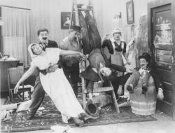 Chaplin creates mild hi-jinks in the early short Work.