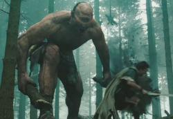A giant Cyclops chases Sam Worthington as Perseus in Wrath of the Titans.