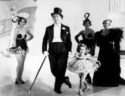 James Dunn, Shirley Temple and chorus girls in Stand Up and Cheer!